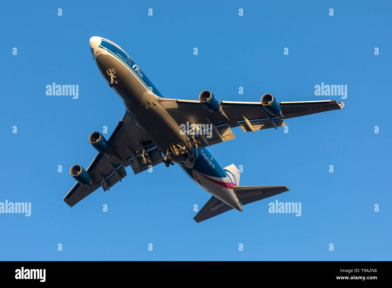 CargoLogicAir Boeing 747-446F/SCD (G-CLAA) on long finals runway 31 in the last rays of sunlight. Stock Photo