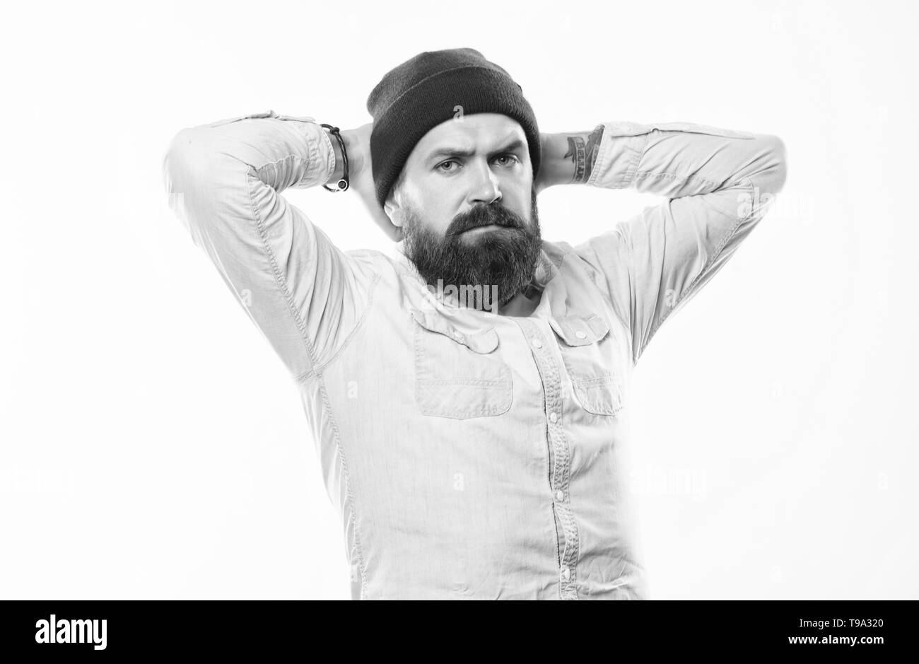 Barbershop concept. Man bearded with mustache brutal masculine appearance. Hipster style and fashion. Hipster bearded guy wear bright hat accessory. Bearded man posing confidently on white background. - Stock Image