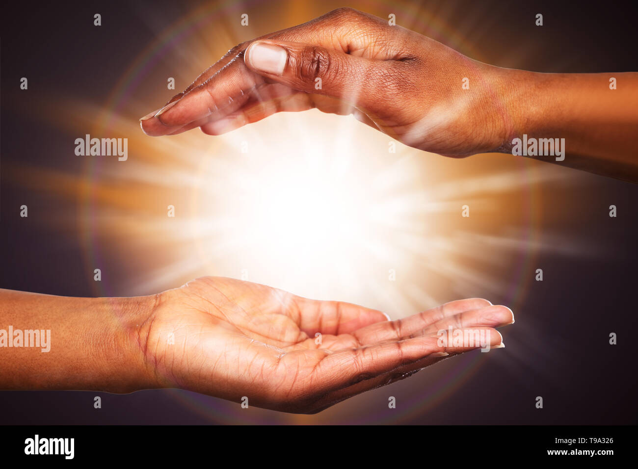 Close-up Of Mysterious Glowing Power In The Hands - Stock Image