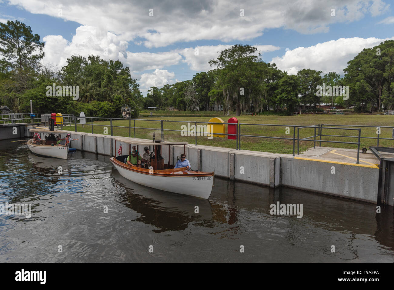 Steamboats leaving the Burrell Navigational lock and Dam located on the Haines Creek in Leesburg, Florida USA - Stock Image