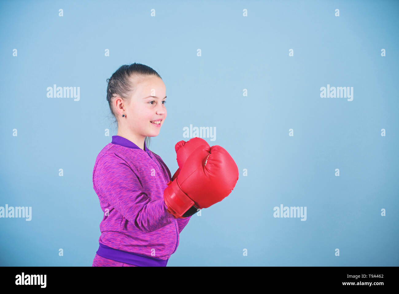 workout of small girl boxer. Sport success. sportswear fashion. Fitness diet. energy health. Happy child sportsman in boxing gloves. punching knockout. Childhood activity. Sporty beauty. - Stock Image