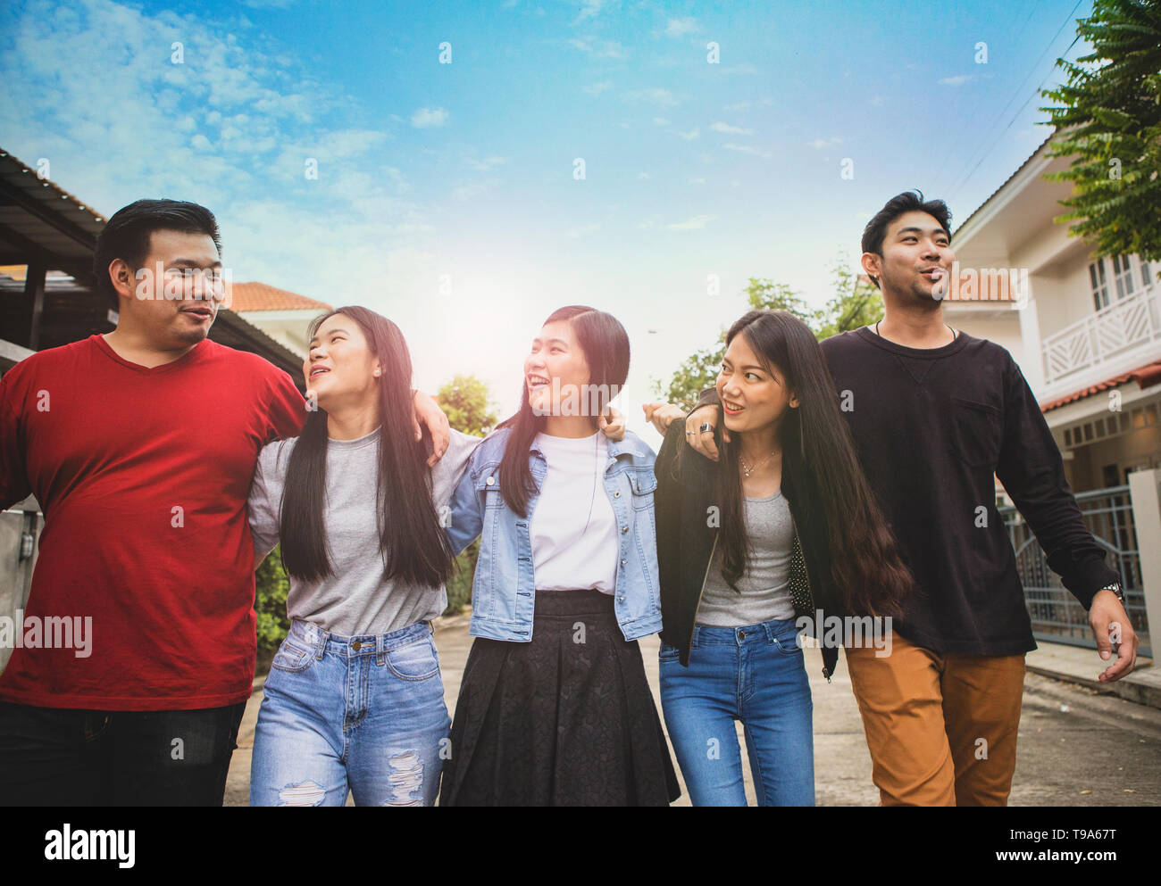 group of asian younger man and woman relaxing toothy smiling face with happiness emotion - Stock Image