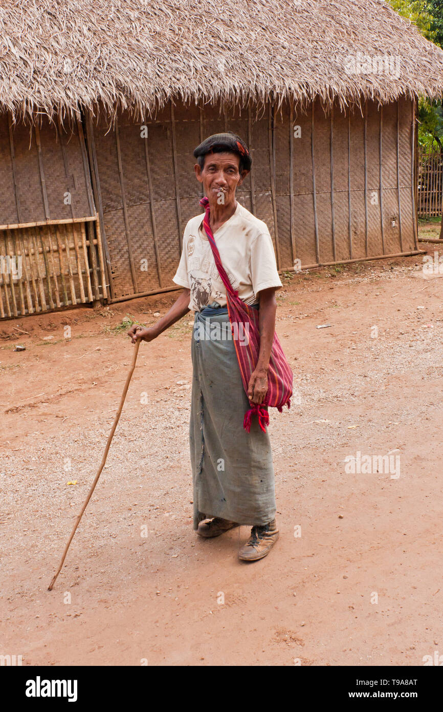 A Man Of The Shan People Holding A Stick Smoking A Cigar Wearing The Traditional Burmese Skirt Longyi And A Traditional Shoulder Bag Myanmar Stock Photo Alamy