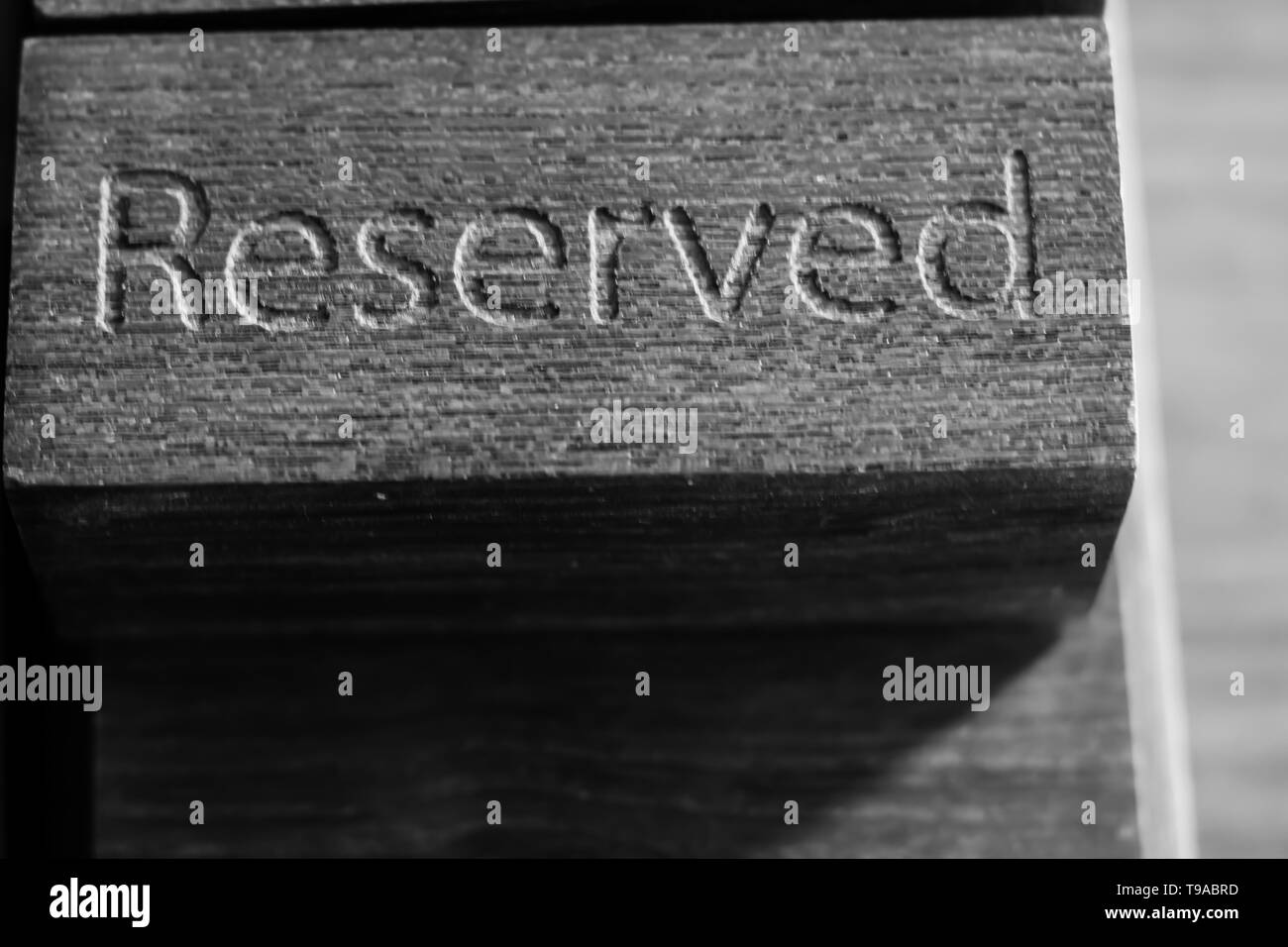Reserved Wooden table in restaurant black and white photo - Stock Image