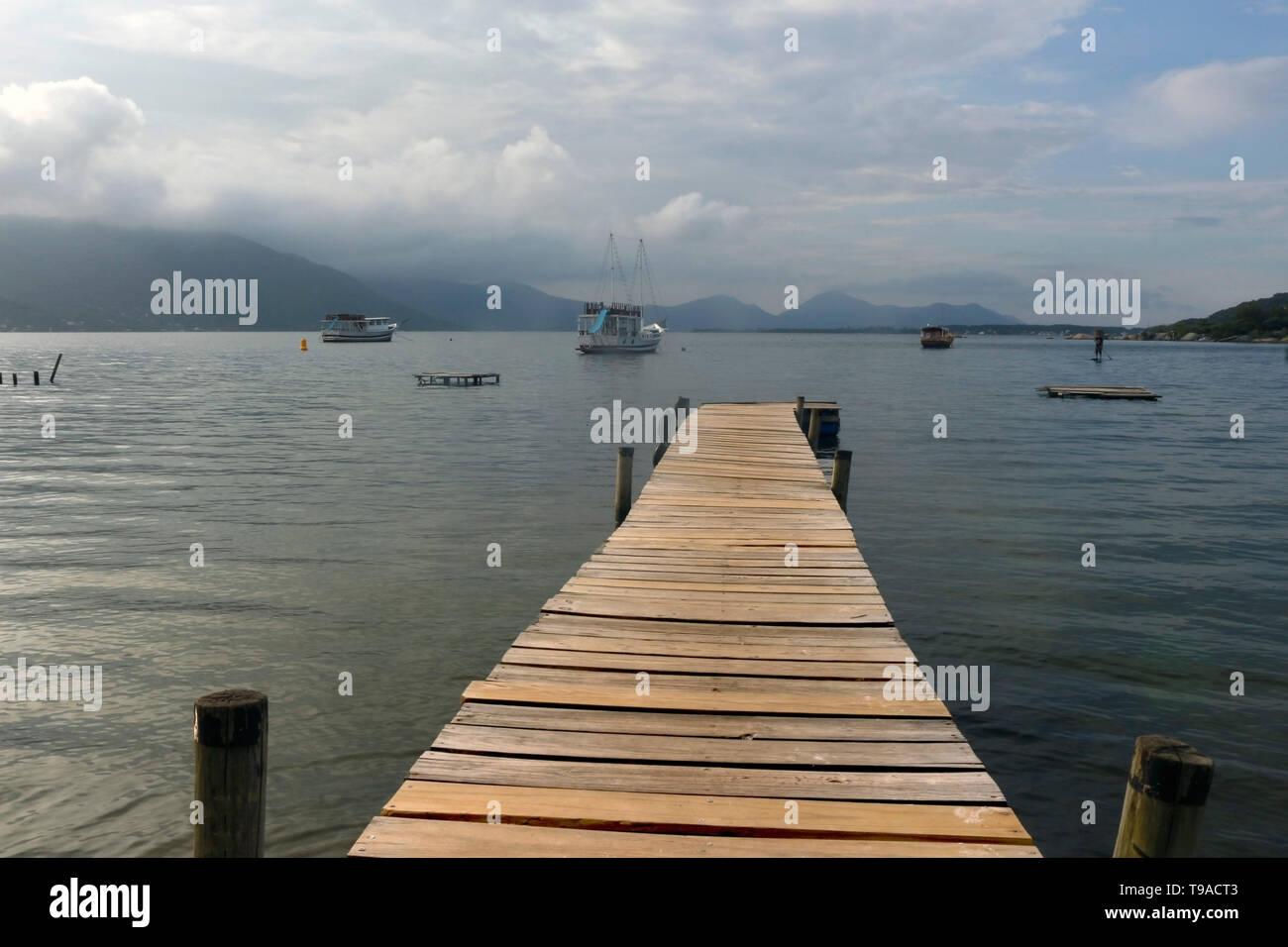 Wooden Pier in Conceição Lagoon - Florianopolis - SC - Brazil - Stock Image