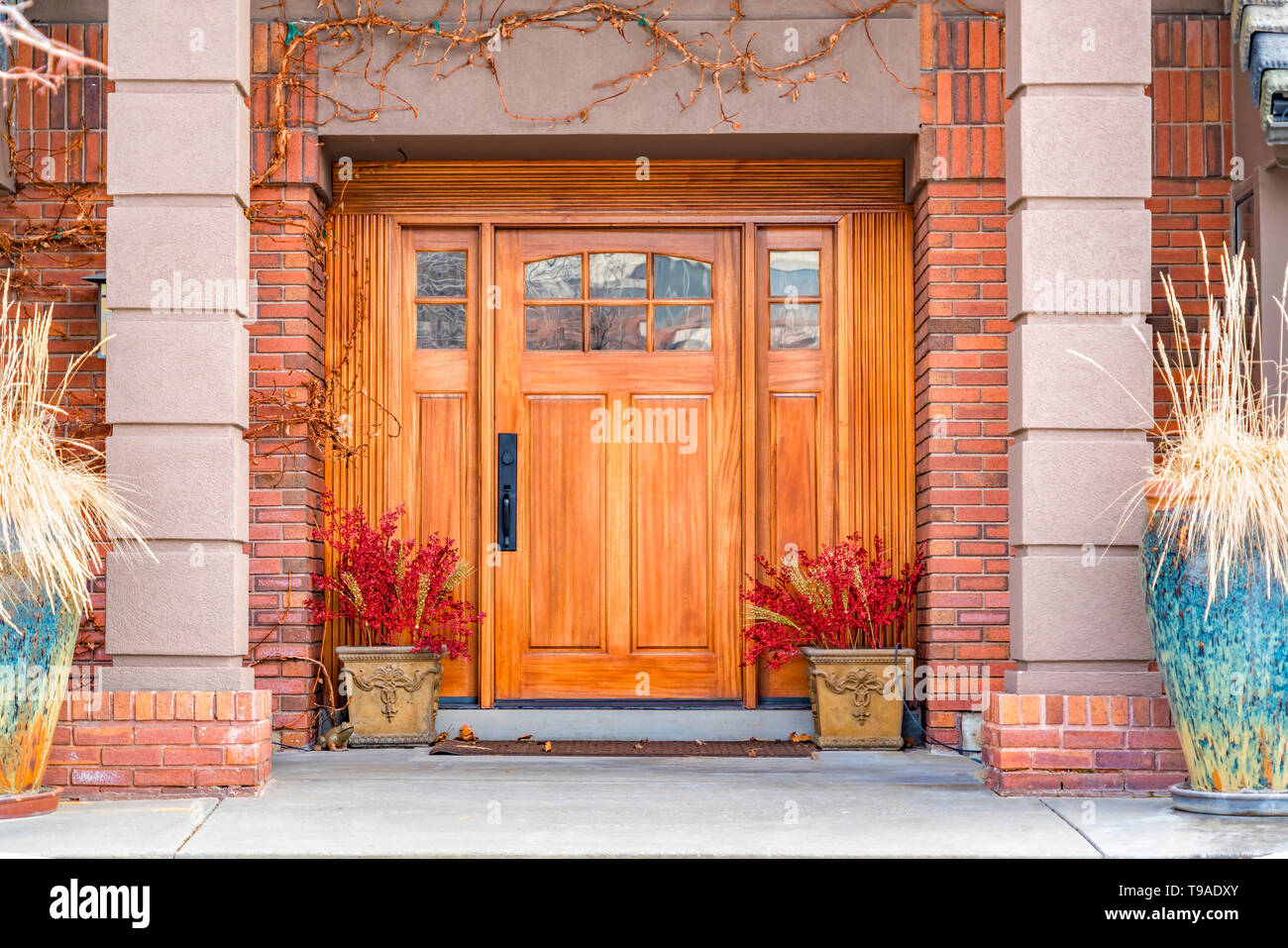 Brown Wooden Front Door With Decorative Glass Panels At The Entrance Of A Home Stock Photo Alamy