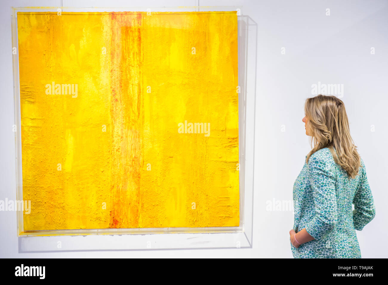 London, Uk. 17th May 2019. Yellow Giallo 2016 by Marcello  Lo Giudice - Spaziale! at Opera Gallery London. Organised in collaboration with the Italian Embassy in London, the exhibition includes 40 iconic canvases by Lucio Fontana, Agostino Bonalumi and Enrico Castellani among others. Credit: Guy Bell/Alamy Live News - Stock Image