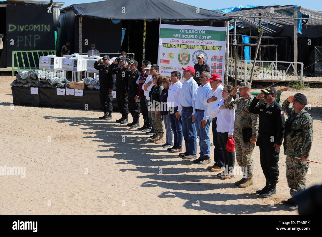 La Pampa, Peru. 17th May, 2019. The Peruvian president, Martin Vizcarra (C), accompanied by political, civil and military authorities, participates in the delivery of equipment donated by the United States to the Government of Peru to help the local police in the recovery efforts of the deforested area known as La Pampa, the largest illegal mining camp located in the southern region Amazonia of Madre de Dios, Peru, 17 May 2019. Credit: Ernesto Arias/EFE/Alamy Live News - Stock Image