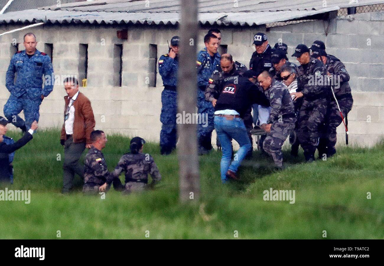 Bogota, Colombia. 17th May 2019. Members of the Technical Body of Investigation (CTI lit. Spanish) and of the Penitentiary Institure get former guerrilla leader known as 'Jesus Sanctrich' (C-L, wheelchair) on a helicopter for his transfer to the Attorney's Office, at La Picota prison, in Bogota, Colombia, 17 May 2019, after the Attorney's Office ordered his rearrest. Santrich's extradition to the United States on drug trafficking charges was denied by the Special Justice for Peace (JEP) two days ago, followed by and order to free him. Credit: EFE News Agency/Alamy Live News - Stock Image