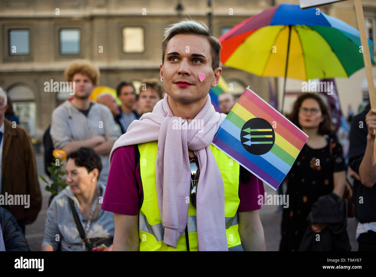 A protester seen holding a rainbow flag during the demonstration. The International Day against Homophobia, Transphobia and Biphobia is celebrated around the world. This date commemorates the deletion of homosexuality from the International Classification of Diseases by the World Health Organization on May 17, 1990. Dozens of LGBTQ activists and supporters gathered in Warsaw to show their opposition to the growing wave of hatred towards the non-heteronormative people and Elzbieta Podlesna, an activist who was arrested recently for designing and distributing posters of Virgin Mary with a rainbo Stock Photo