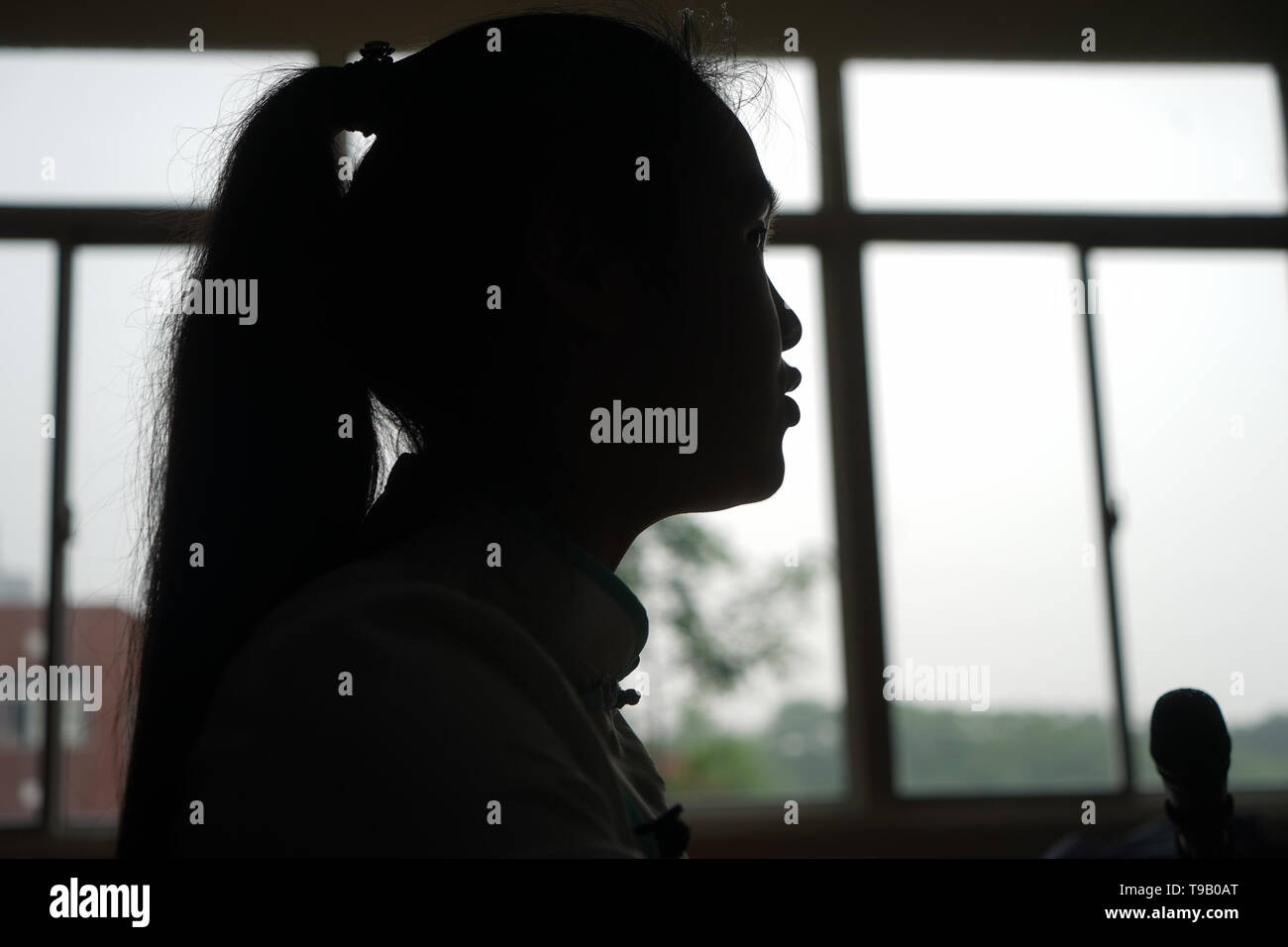 (190518) -- NANJING, May 18, 2019 (Xinhua) -- Zhou Wenqing practises broadcasting skills in a braille library of Nanjing Normal University of Special Education in Nanjing, east China's Jiangsu Province, May 17, 2019. Wu Yifan, 22, and Zhou Wenqing, 21, are schoolmates in Nanjing Normal University of Special Education. Both of them lost eyesight in their childhood. In their spare time, Wu likes doing makeup, paper-cutting as well as playing the Guzheng, Chinese Zither. While Zhou enjoys playing the piano. Zhou once developed a computer game for visually impaired people. The two girls have p - Stock Image