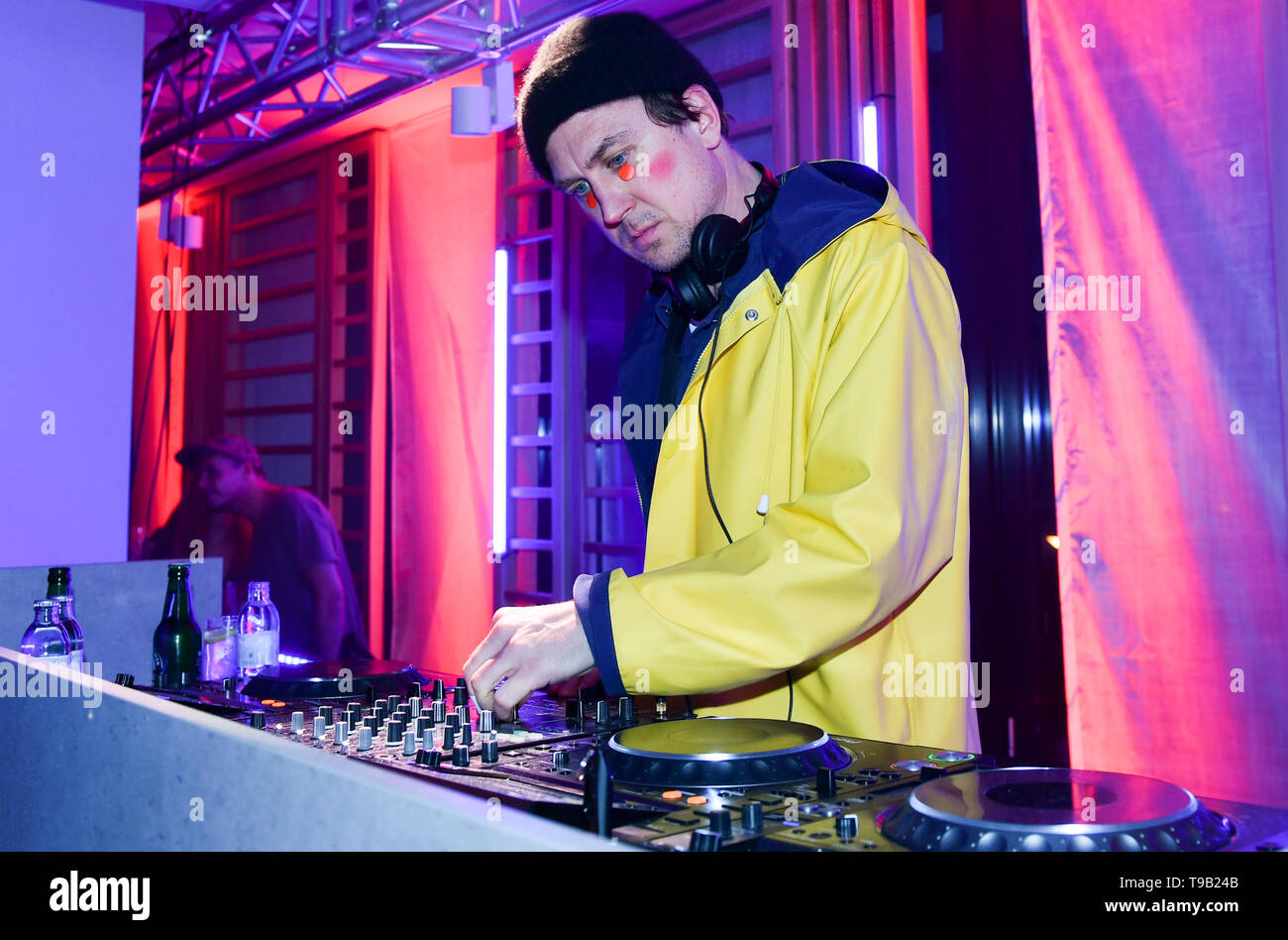 Berlin, Germany. 16th May, 2019. Actor Lars Eidinger DJs the opening of the John & Janes Soulbase Yoga, Pilates and Barre Studios at the party with glued-on dots and red cheeks. The boutique fitness concept combines the international sports trends of yoga, Pilates and barre with other fitness elements. Credit: Jens Kalaene/dpa-Zentralbild/ZB/dpa/Alamy Live News - Stock Image