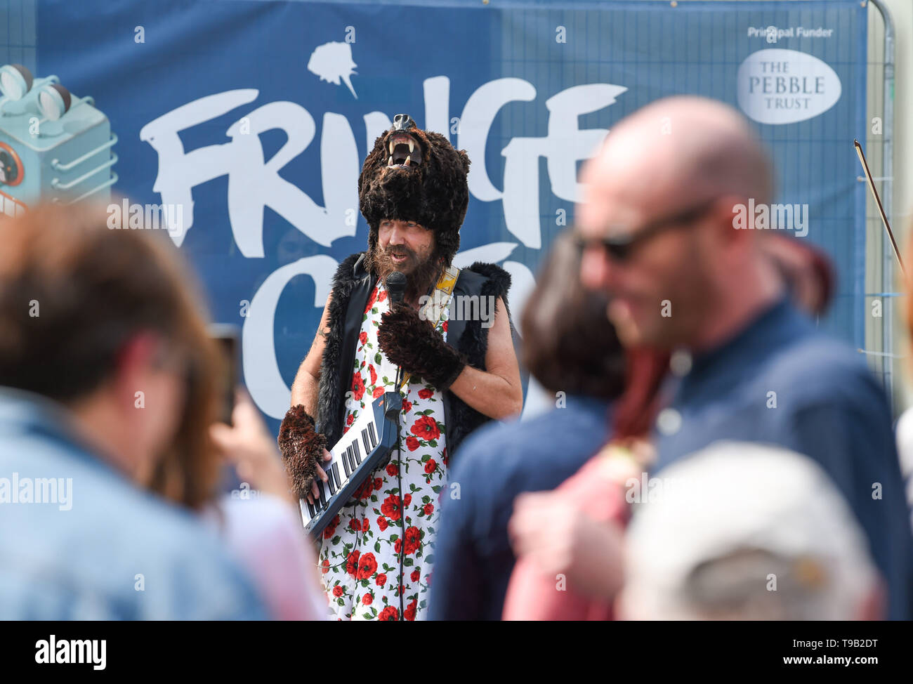 Brighton UK 18th May 2019 - A singing bear in a dress part of the 'Bear North' show at the Fringe City street entertainment which is part of the Brighton Festival 2019 . Credit : Simon Dack / Alamy Live News - Stock Image