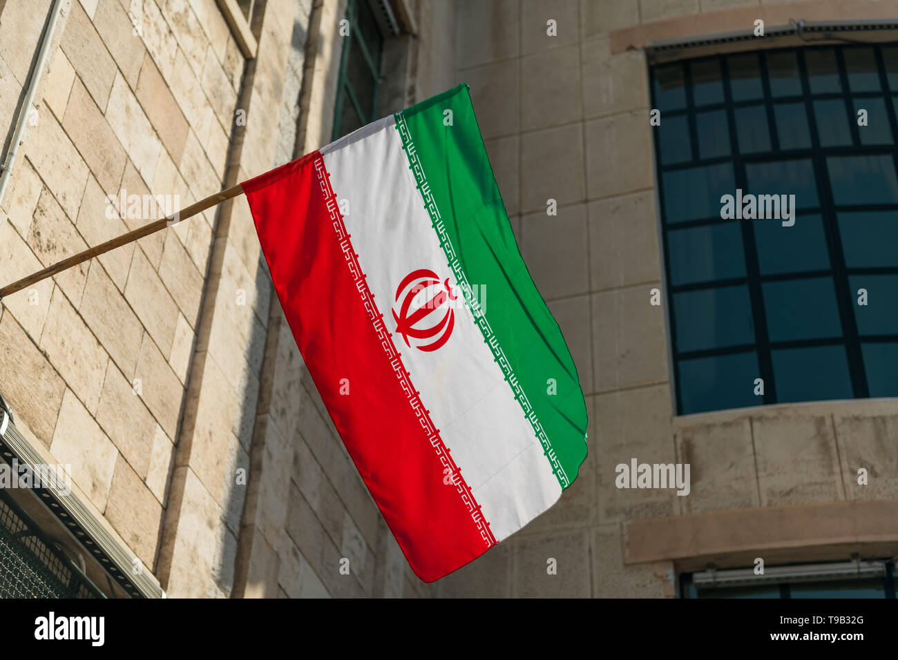 A waving Iranian flag in a house. Stock Photo