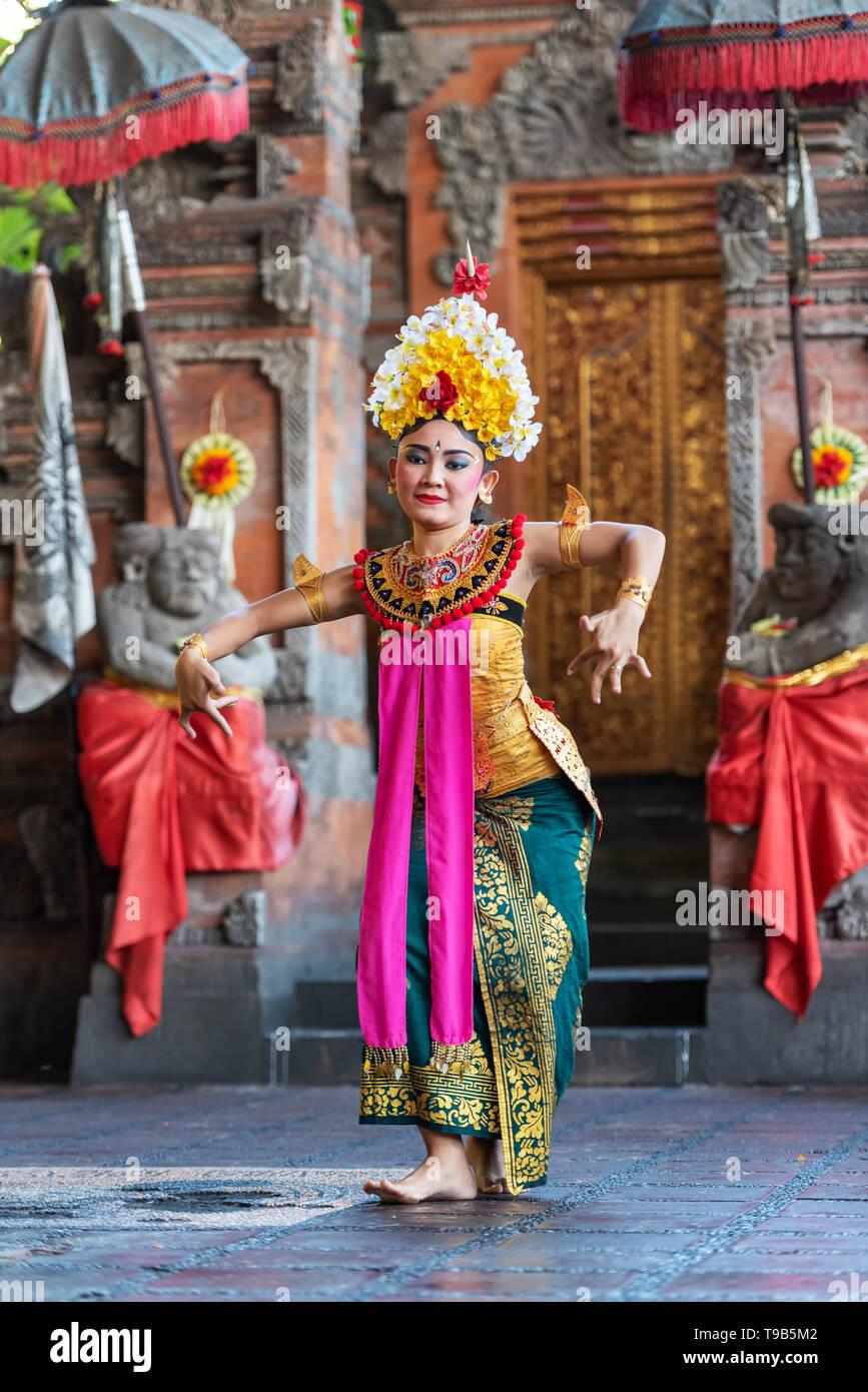 Denpasar, Indonesia - March 28, 2019: Legong dance performance, Balinese traditional dancing. - Stock Image