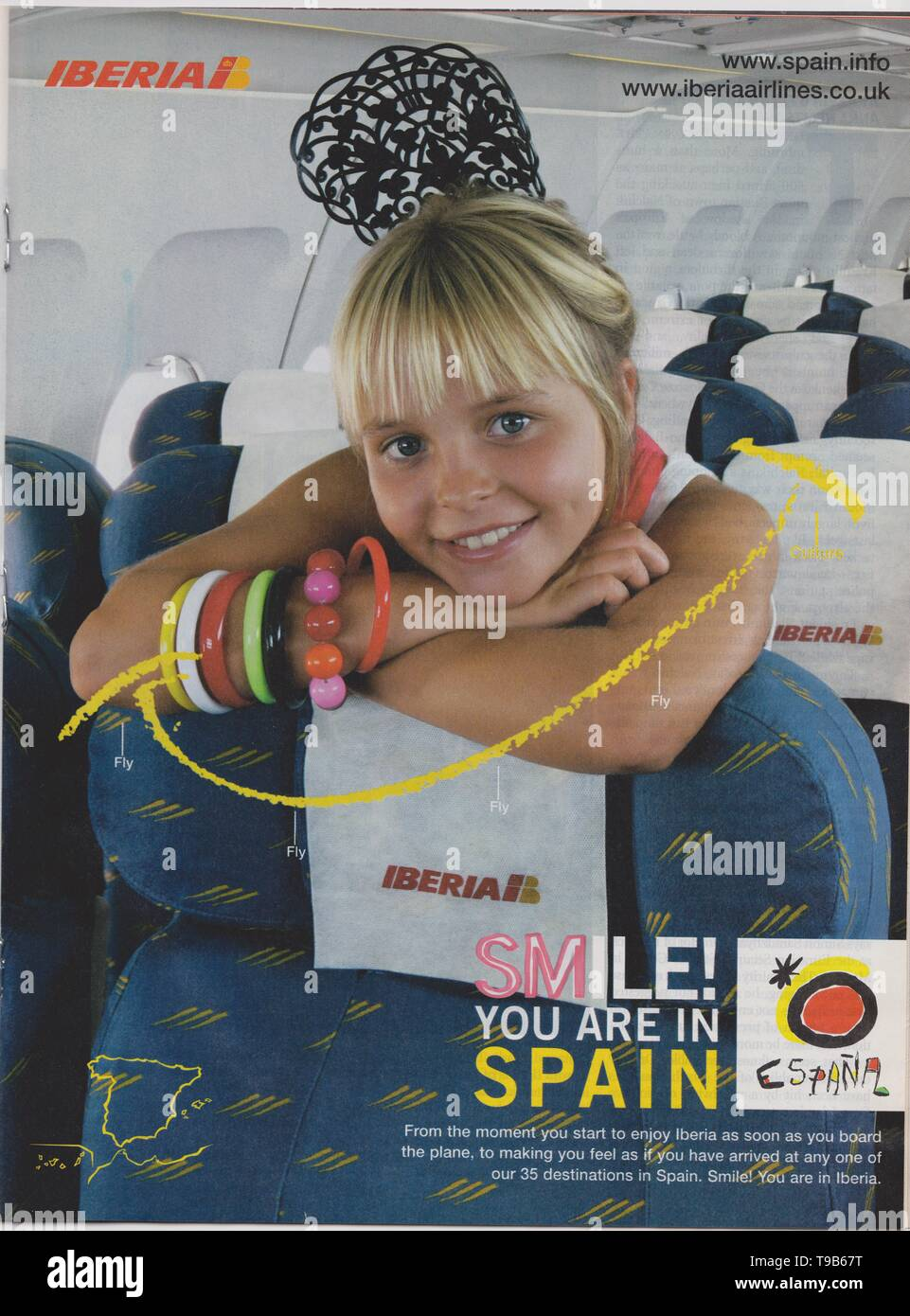 Lodz, Poland, April 13, 2019 poster advertising Iberia Airlines in magazine from 2005, SMILE! YOU ARE IN SPAIN slogan, advertisement, creative advert - Stock Image