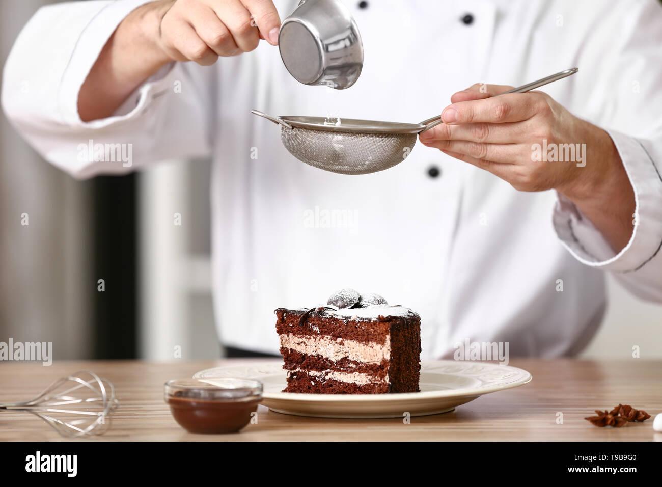 Male chef decorating tasty dessert in kitchen, closeup Stock ...