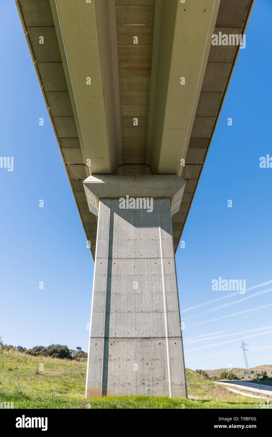Views from below of an overpass of the train tracks near Grimaldo - Stock Image