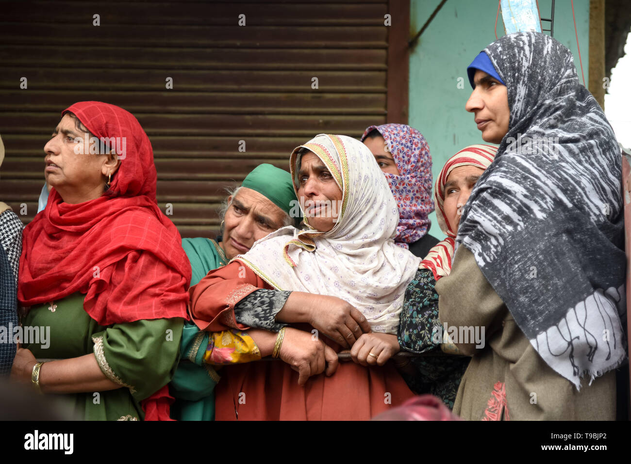 Kashmiri women seen mourning during the funeral procession of slain JeM Militant Naseer Ahmed Pandit during his funeral at his residence in Pulwama, South of Srinagar. Three militants, an army man and a civilian were killed in a fierce gunfight that broke out in Dalipora area of Pulwama town in south Kashmir on Thursday morning. - Stock Image
