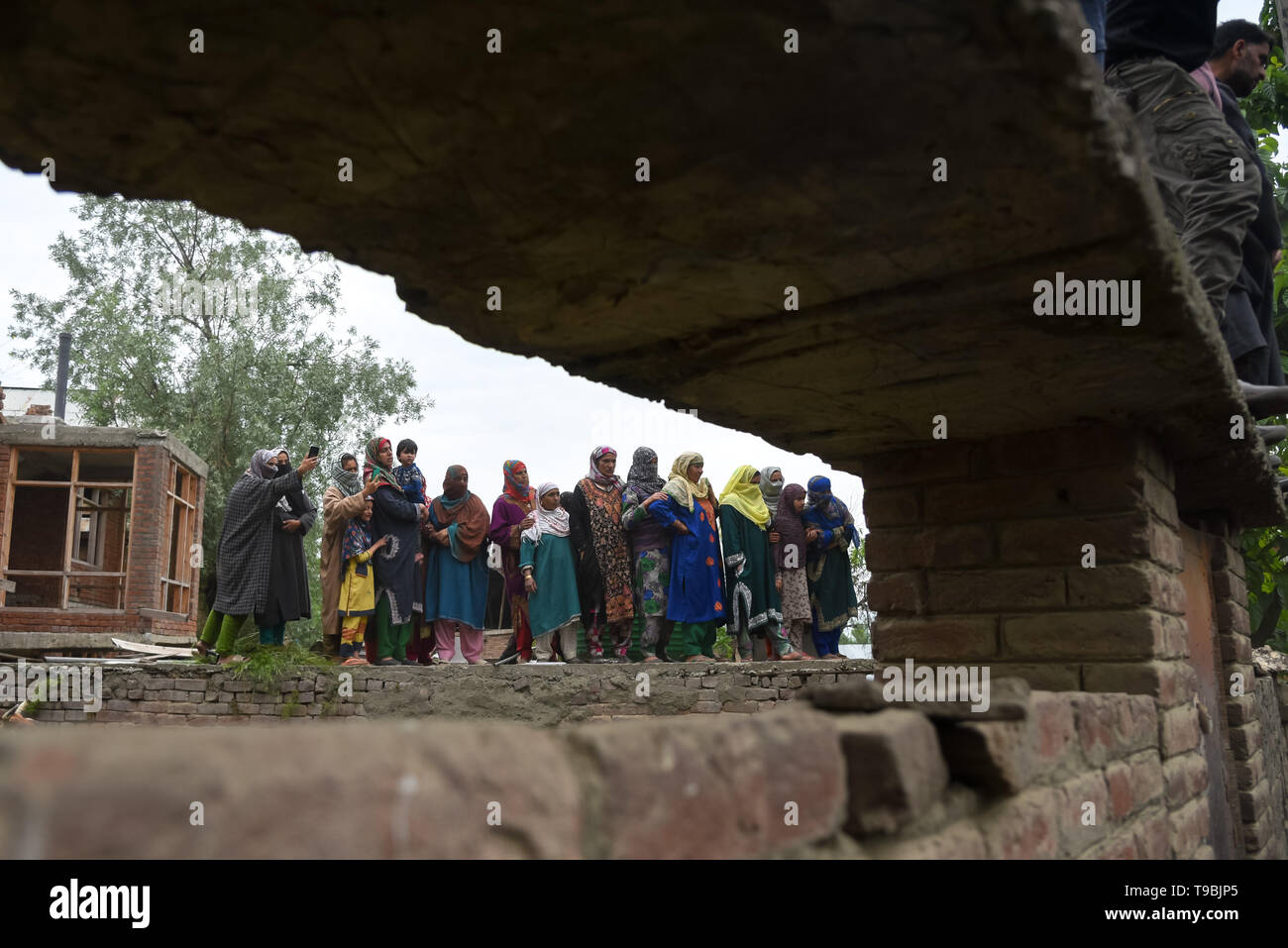 Kashmiri villagers seen during the funeral procession of slain JeM Militant Naseer Ahmed Pandit at his residence in Pulwama, South of Srinagar. Three militants, an army man and a civilian were killed in a fierce gunfight that broke out in Dalipora area of Pulwama town in south Kashmir on Thursday morning. - Stock Image