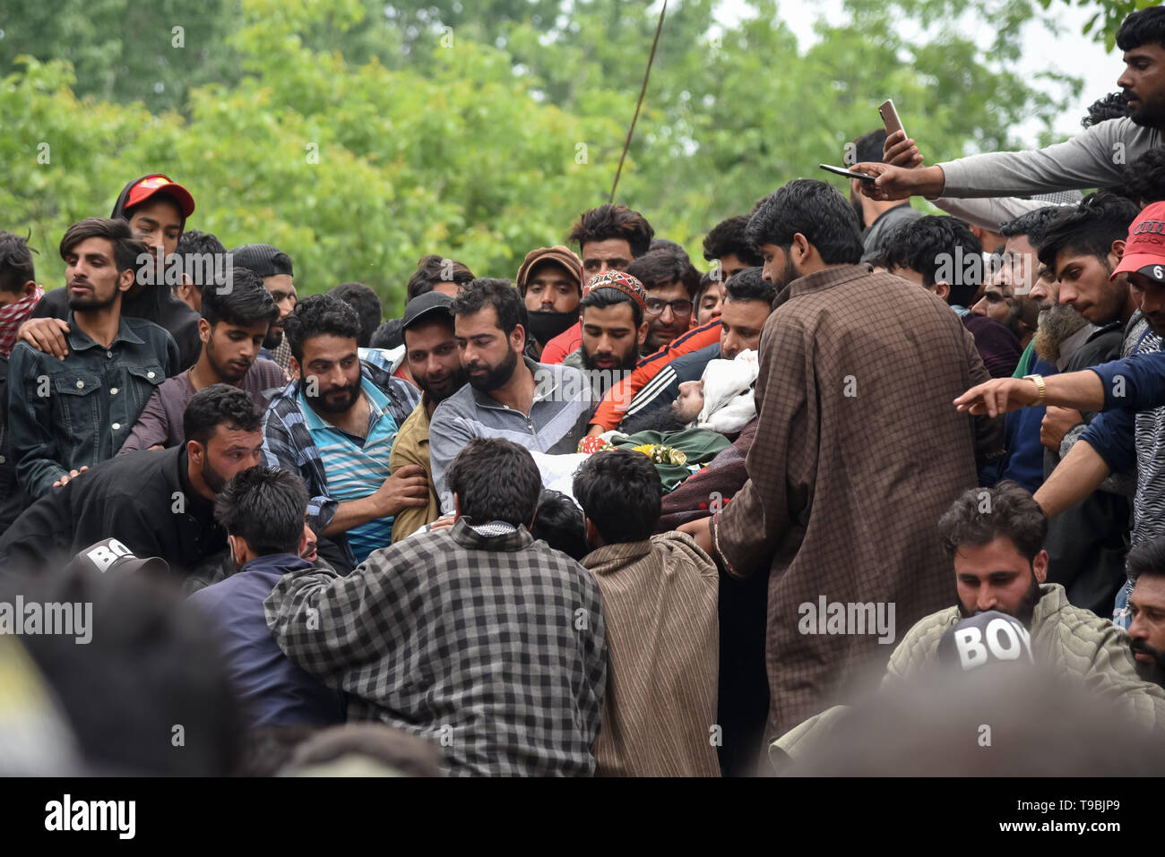 (EDITOR'S NOTE: Image depicts death) Kashmiri villagers seen carrying dead body of JeM Militant Naseer Ahmed Pandit during his funeral at his residence in Pulwama, South of Srinagar. Three militants, an army man and a civilian were killed in a fierce gunfight that broke out in Dalipora area of Pulwama town in south Kashmir on Thursday morning. - Stock Image