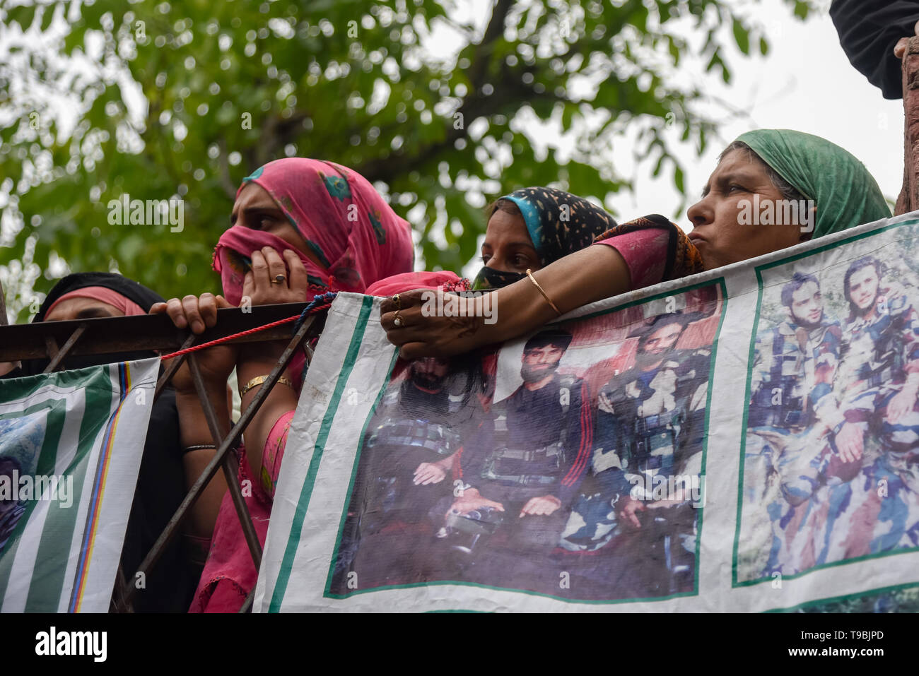 Kashmiri women seen during the funeral procession of slain JeM Militant Naseer Ahmed Pandit at his residence in Pulwama, South of Srinagar. Three militants, an army man and a civilian were killed in a fierce gunfight that broke out in Dalipora area of Pulwama town in south Kashmir on Thursday morning. - Stock Image