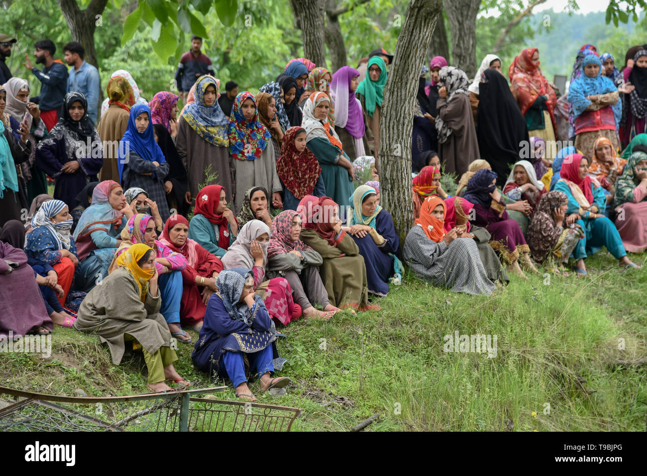 Kashmiri women seen during the funeral procession of slain Naseer Ahmed Pandit at his residence in Pulwama, South of Srinagar. Three militants, an army man and a civilian were killed in a fierce gunfight that broke out in Dalipora area of Pulwama town in south Kashmir on Thursday morning. - Stock Image