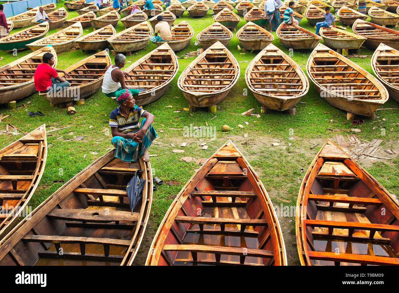 Hundreds of little wooden boats seen displayed for sale at a