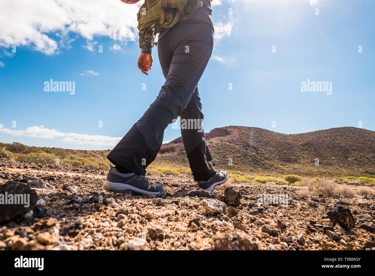 Unrecognizable people lady doing trekking outdoor sport activity in the mountains viewed from back - backpack adventure and enjoying nature - freedom  - Stock Image