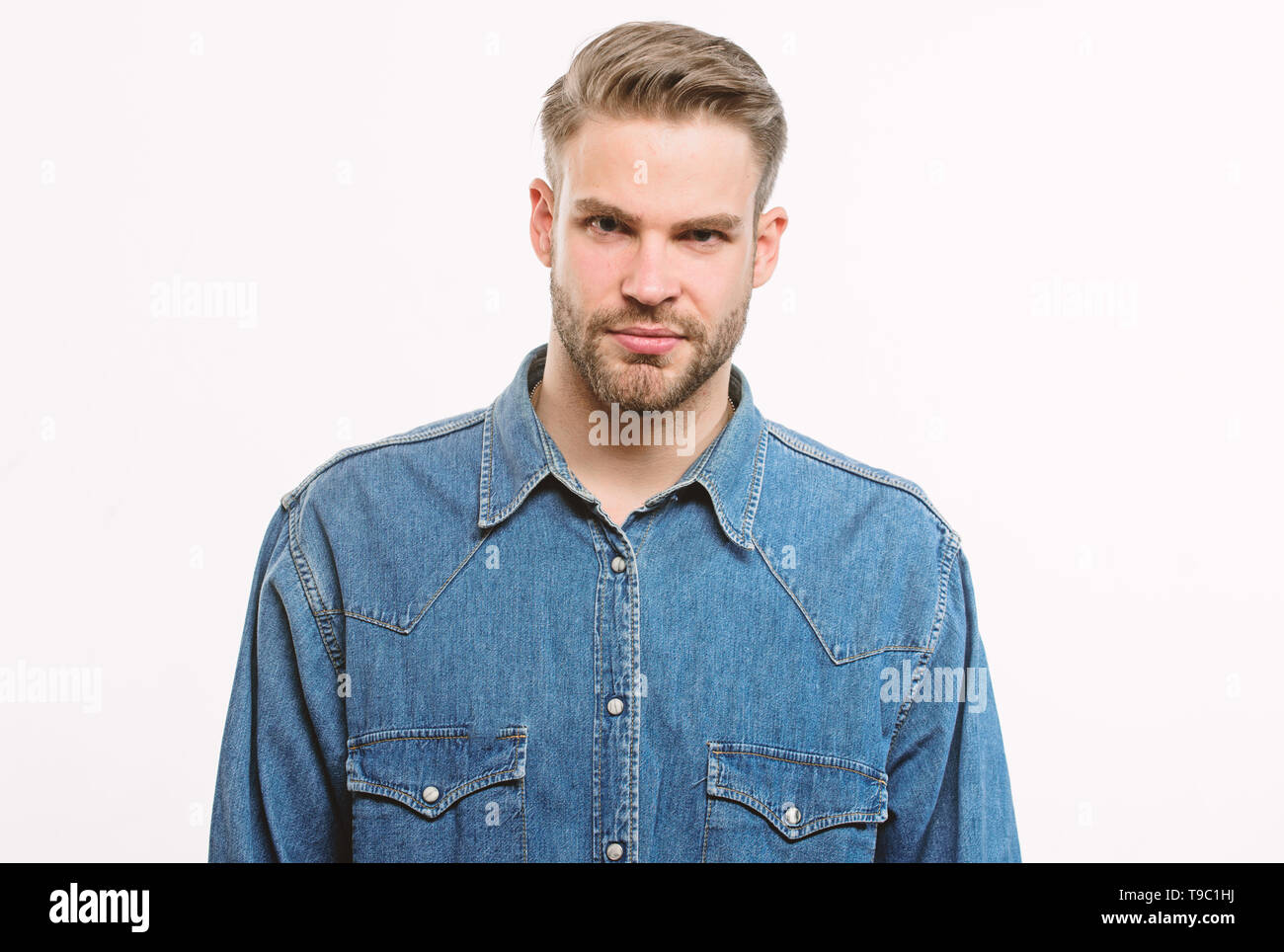 Hipster in denim shirt looks attractive white background. Man well groomed beard and confident face. Well groomed macho. Barber and beard care. Beard grooming salon. Barber salon. Beard grooming. - Stock Image