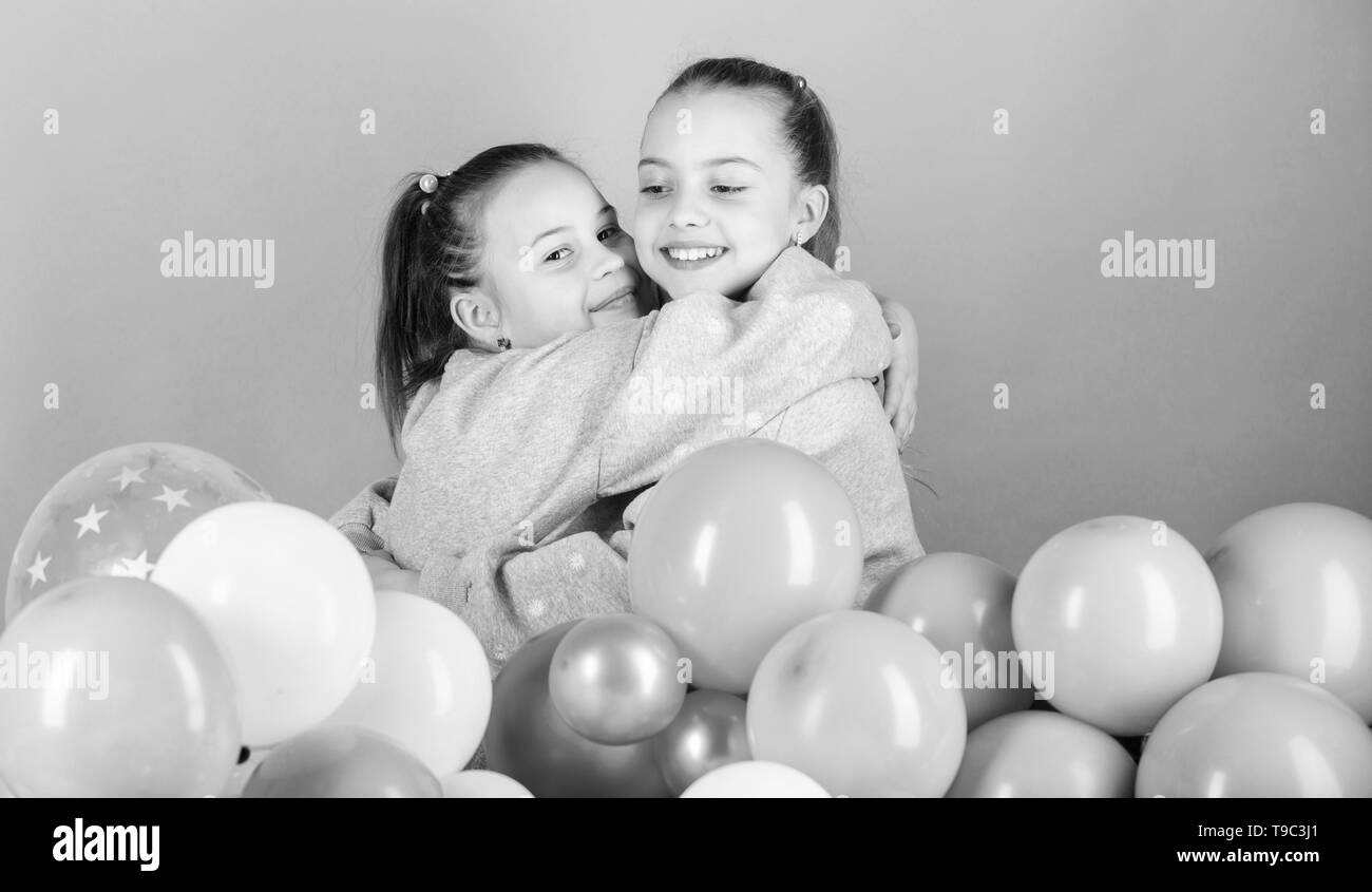 Balloon theme party. Girls best friends near air balloons. Birthday party. Happiness and cheerful moments. Carefree childhood. Start this party. Sisters organize home party. Having fun concept. - Stock Image