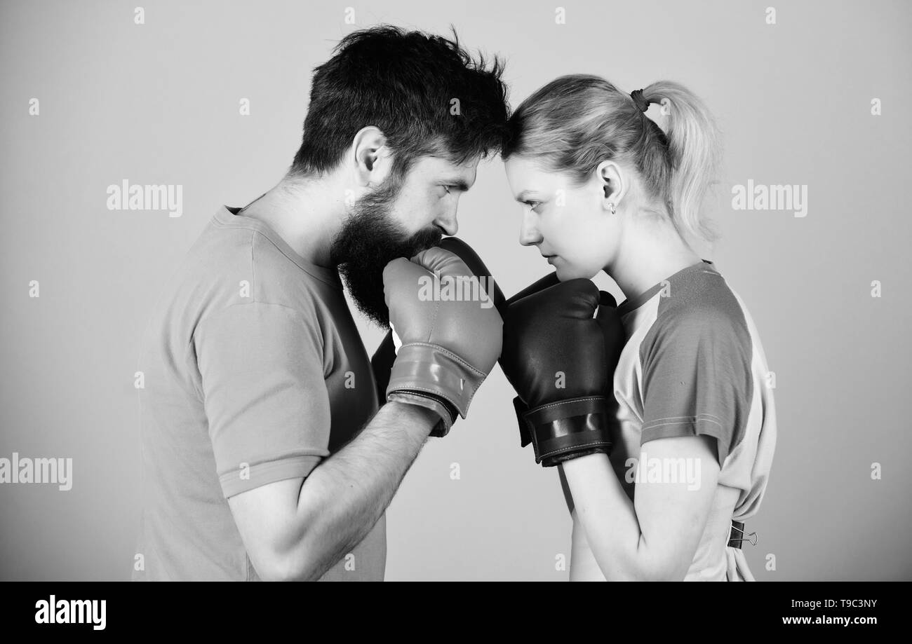 training with coach. Happy woman and bearded man workout in gym. punching, sport Success. sportswear. Fight. knockout and energy. couple training in boxing gloves. One team, one dream. - Stock Image
