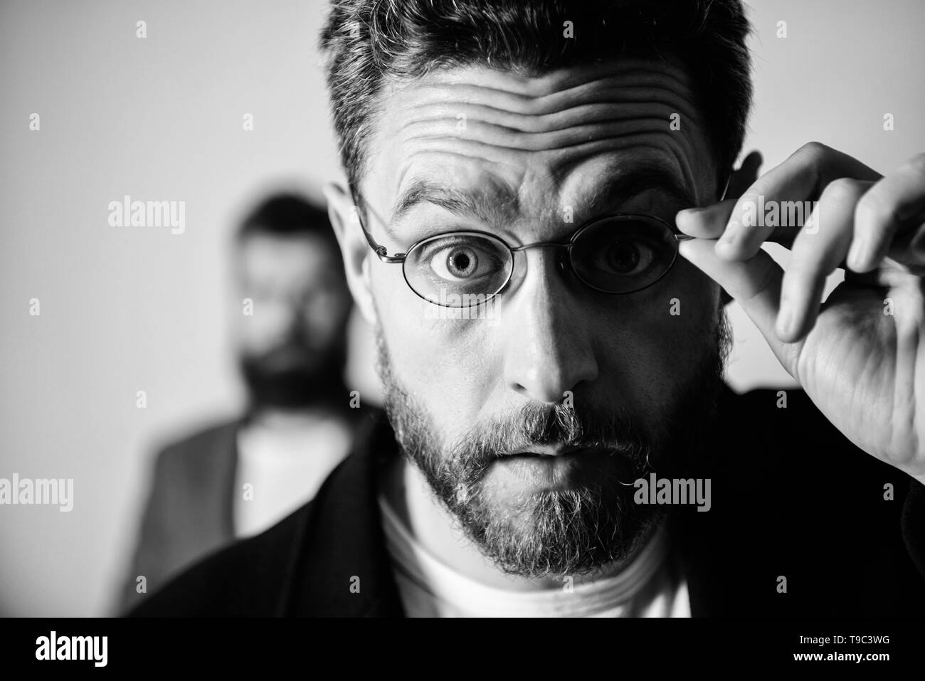 Now i see everything. Picky smart inspector. Man handsome bearded guy wear eyeglasses. Eye health and sight. Optics and vision concept. Smart glance. Accessory for smart appearance. Attentive glance. - Stock Image