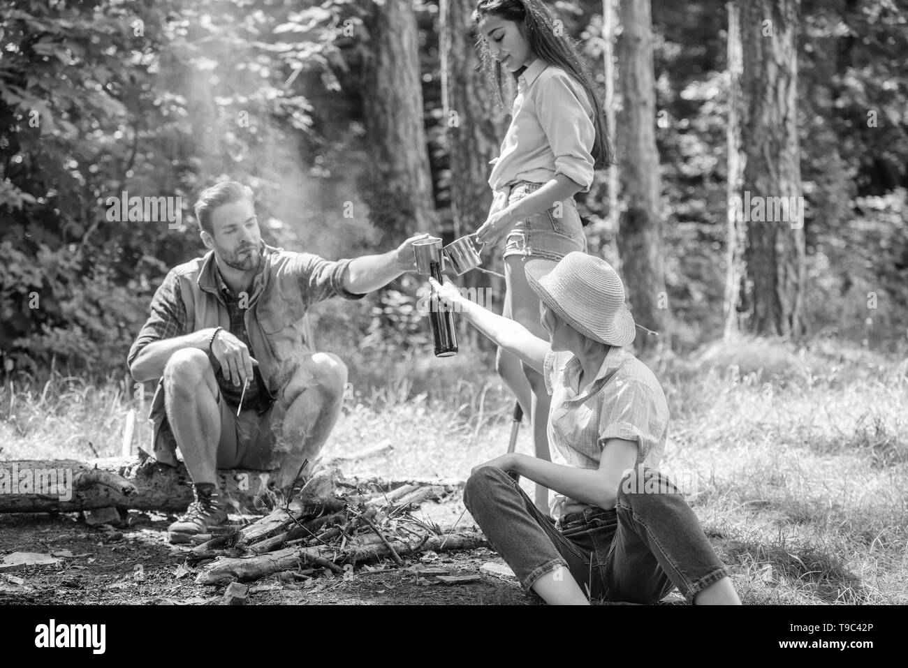 Take a break to have snack. Hikers on picnic. Company friends eat food snack nature background. Company hikers at picnic roasting marshmallows snacks eat food and drink. Spend great time on weekend. - Stock Image