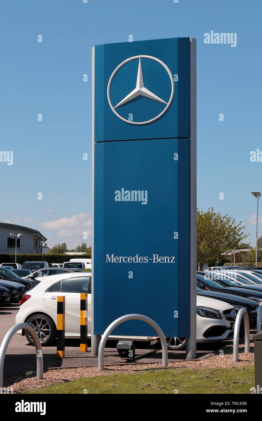 Mercedes Dealership Sign against a clear blue sky Stock Photo