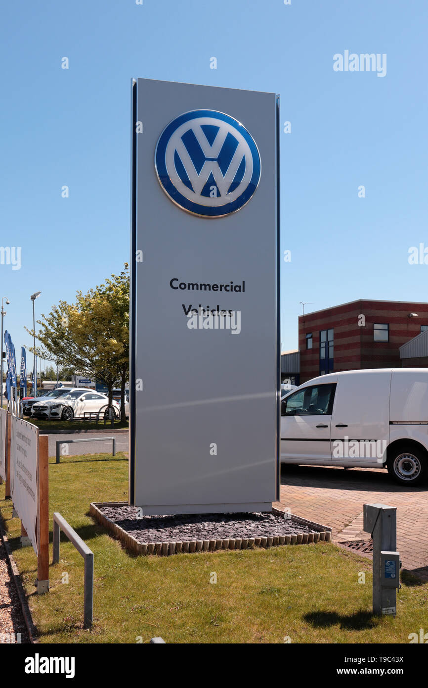 VW Commercial Dealership Sign against a clear blue sky - Stock Image