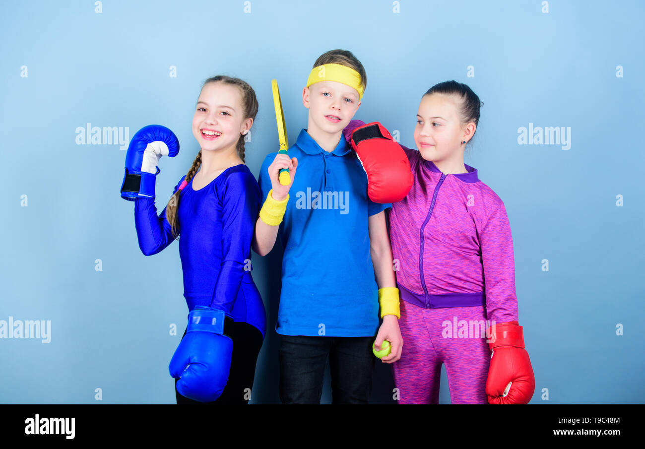 Fitness energy health. punching knockout. Team sport success. workout of small girls boxer and boy in sportswear. Happy children in boxing gloves with tennis racket and ball. boxing. - Stock Image