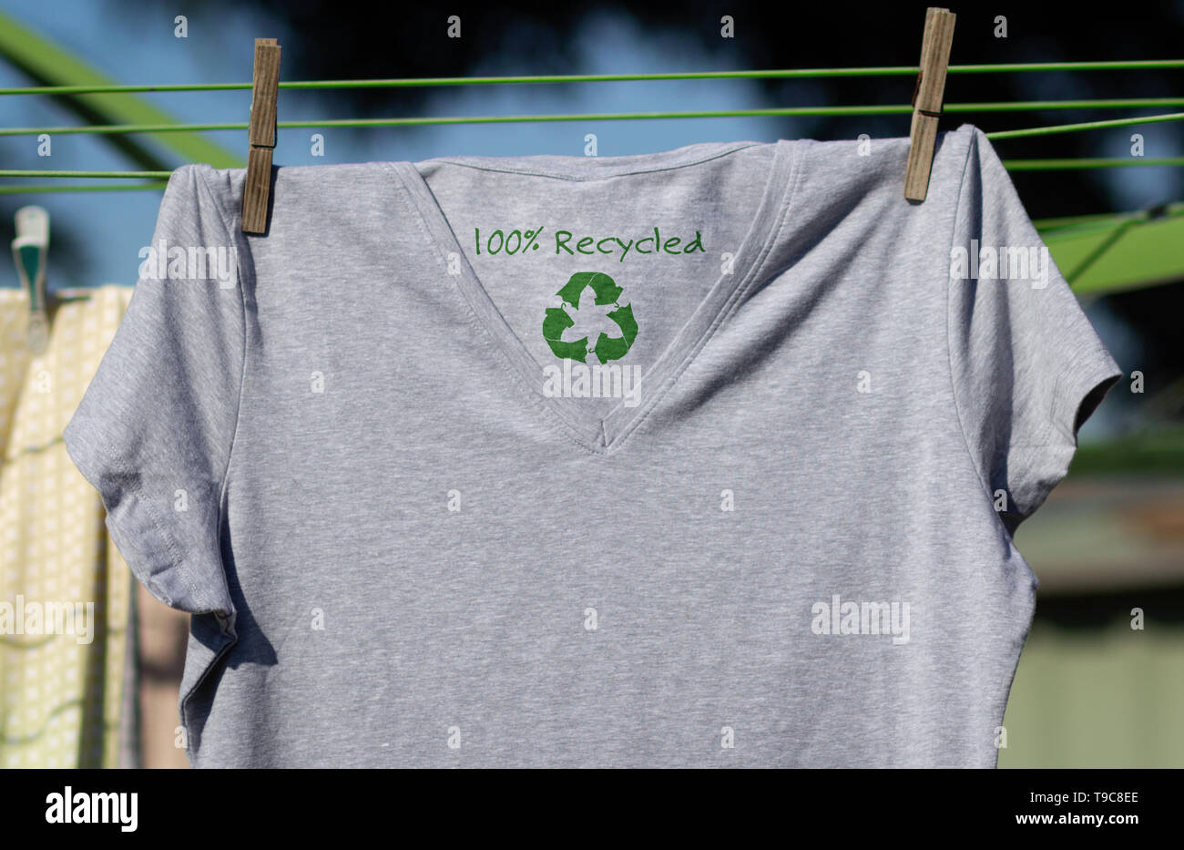 Recycle clothes icon on t shirt with 100% Recycled text, concept illustration reuse, recycle clothes and textiles to reduce waste Stock Photo