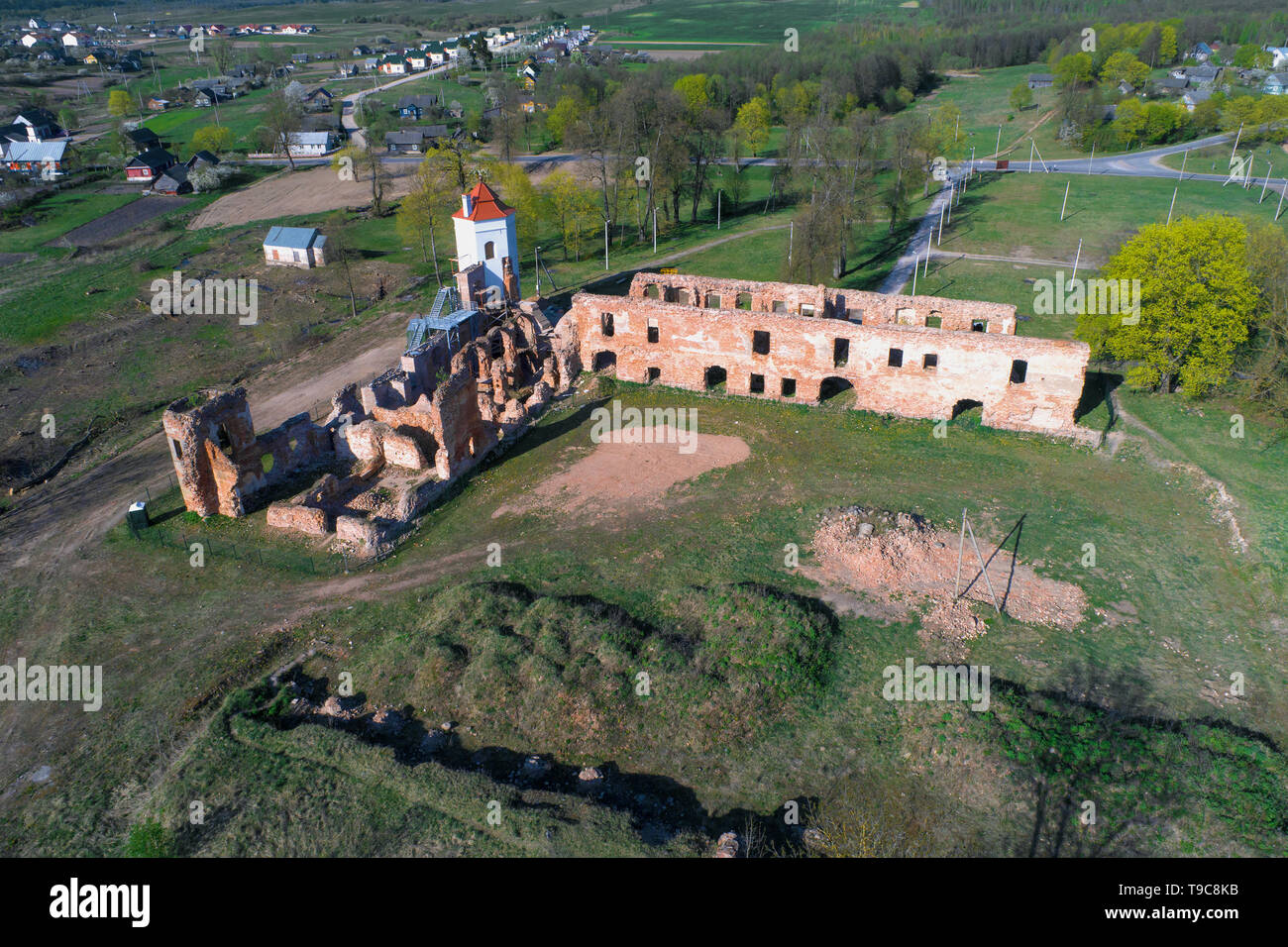 A view from the height of the ruins of the Golshany castle on a sunny April day (aerial photography). Golshany, Belarus - Stock Image