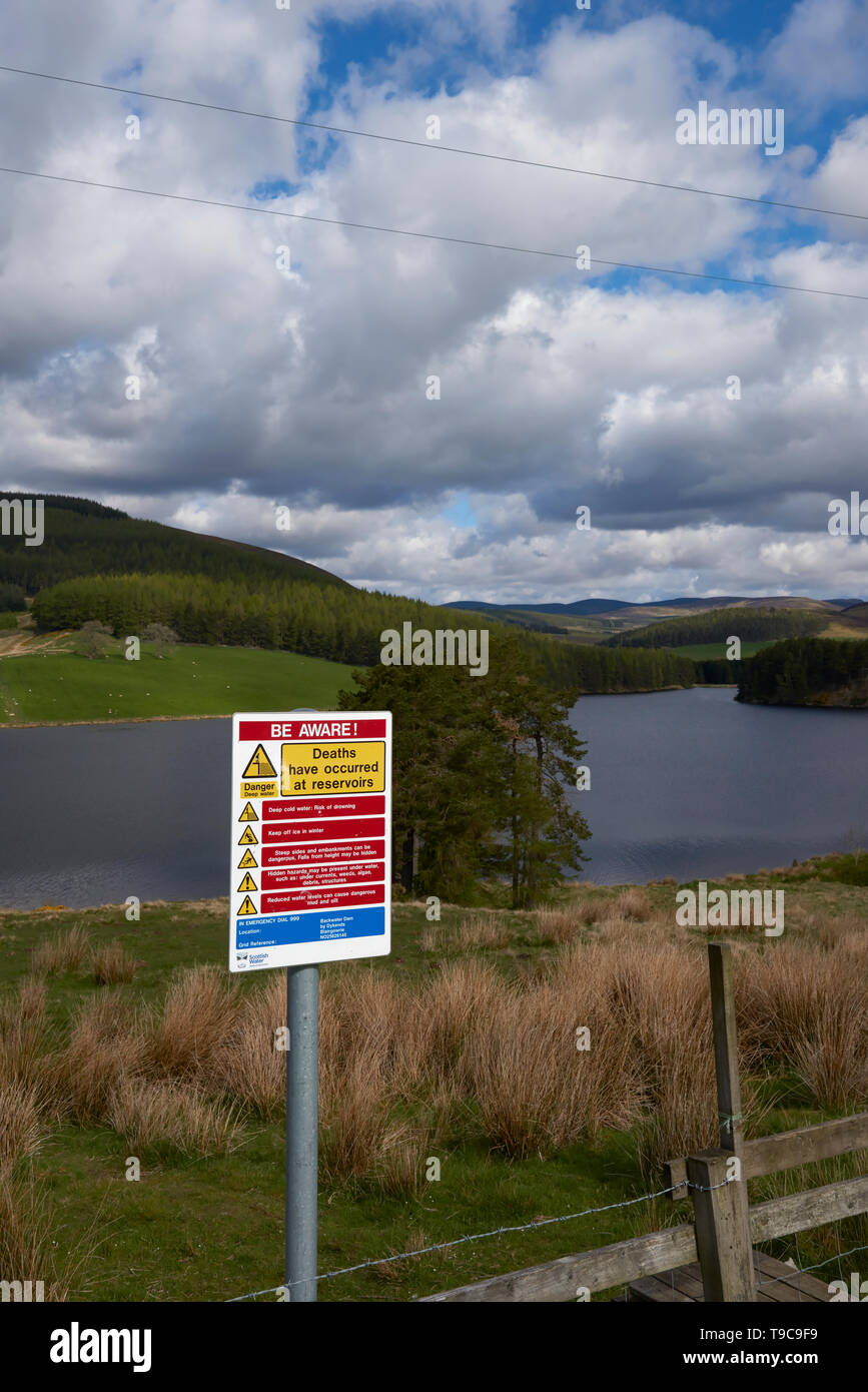 A Be Aware warning Sign near to Backwater Reservoir, mentioning the consequences of swimming in the Reservoir. May, Angus, Scotland. - Stock Image