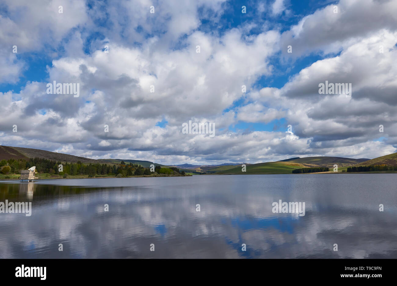 Backwater Reservoir and Pumping House set in the Angus Glens in Glen Isla near to Kirriemuir on a fine May Morning in 2019. Scotland. - Stock Image