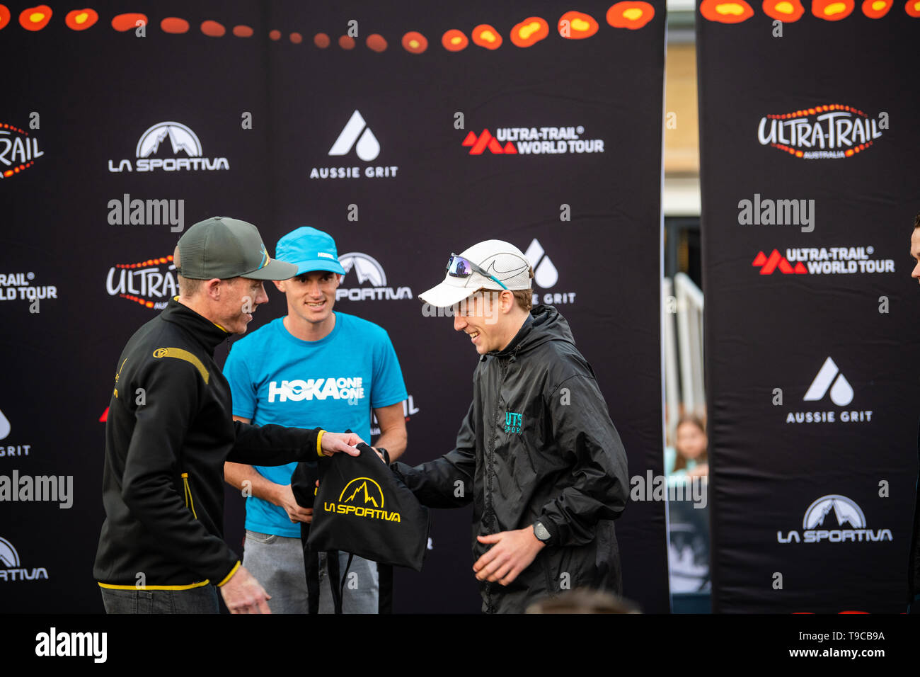 Blue Mountains, Australia - April 16 2019: Ultra-Trail Australia UTA11 race. Over all runner up Will Atkinson receives his prize. - Stock Image