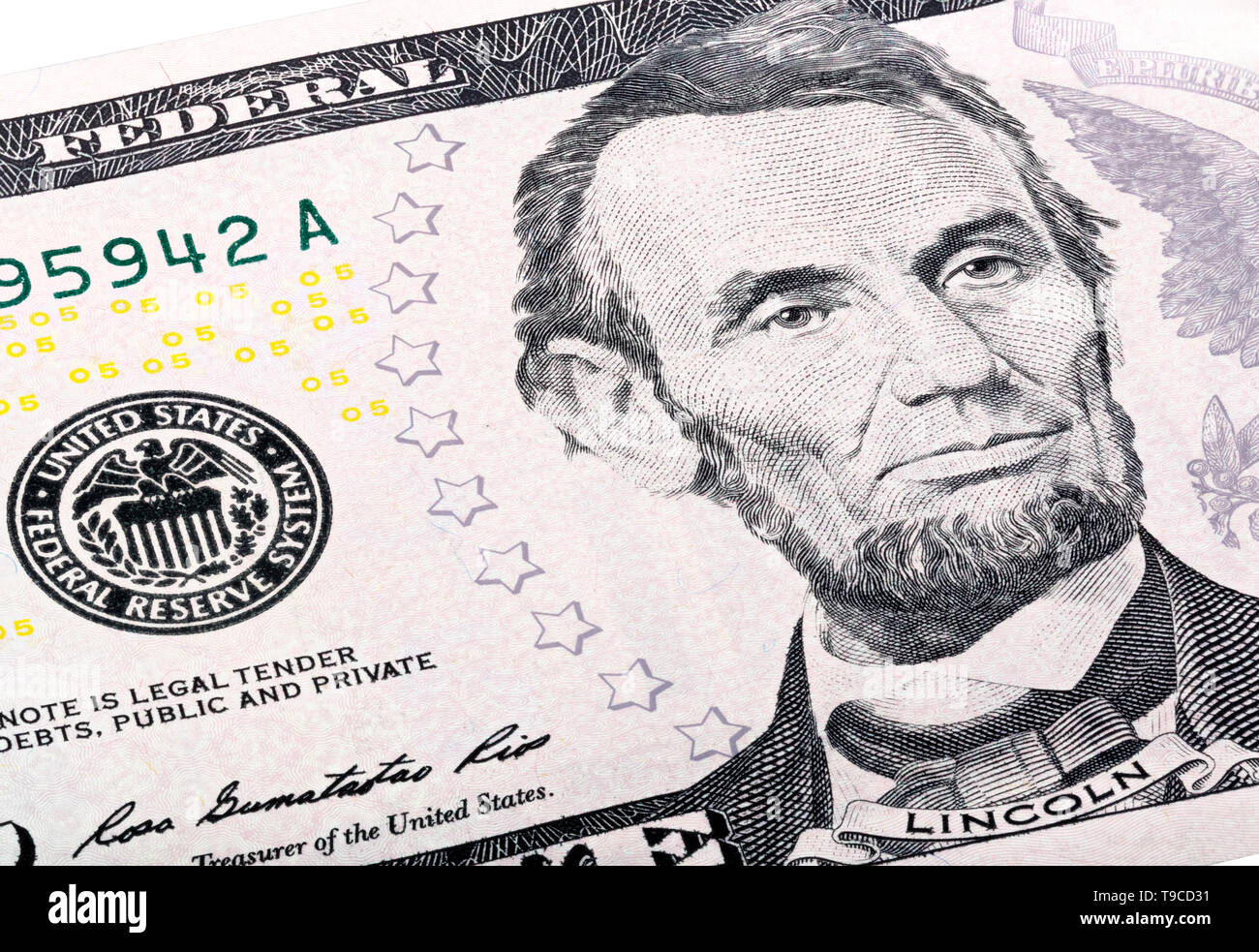 Close-up portrait of Abraham Lincoln end print of Federal Reserve System on five-dollar bill. - Stock Image