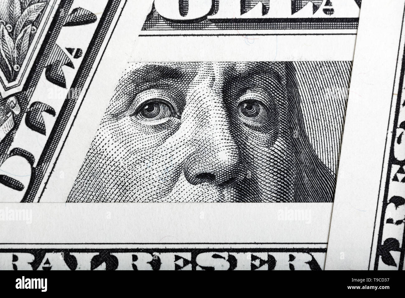 Benjamin Franklin on the one hundred dollar bill framed by one dollar banknotes. - Stock Image