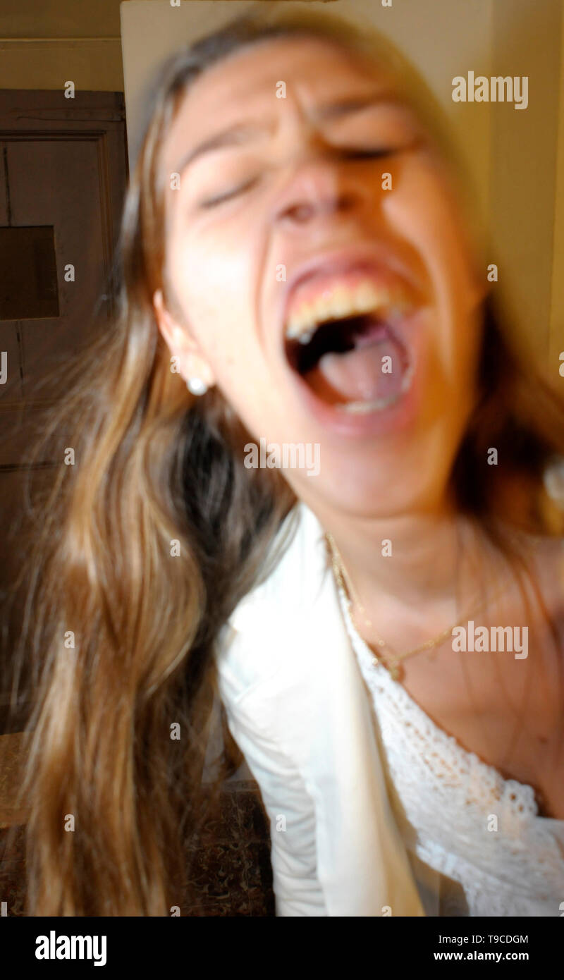 young woman screaming - Stock Image