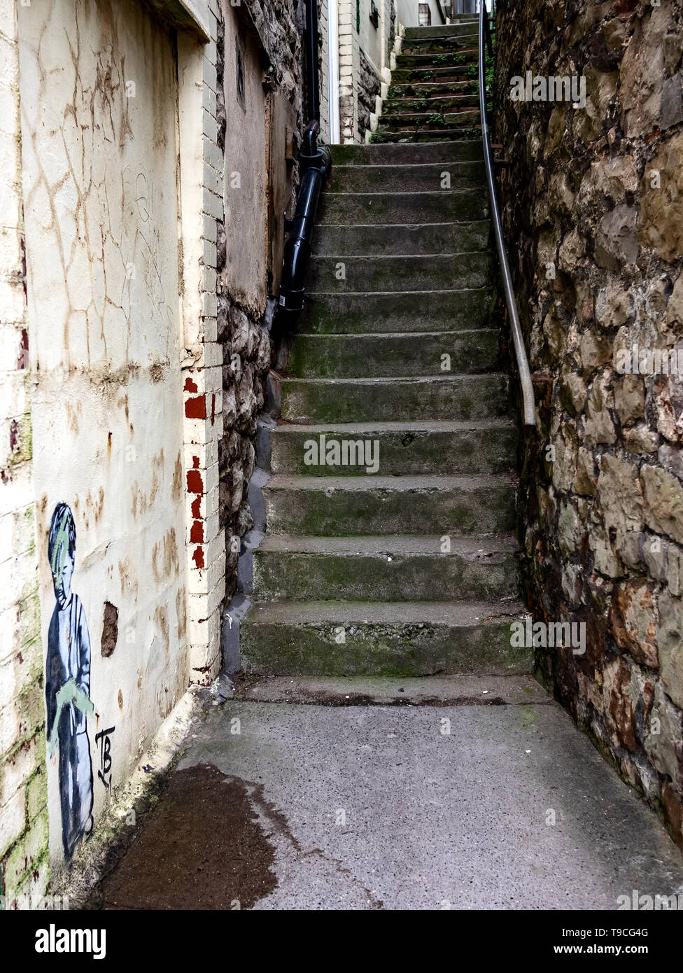 Old stairway in Weston-super-Mare with graffiti on wall - Stock Image