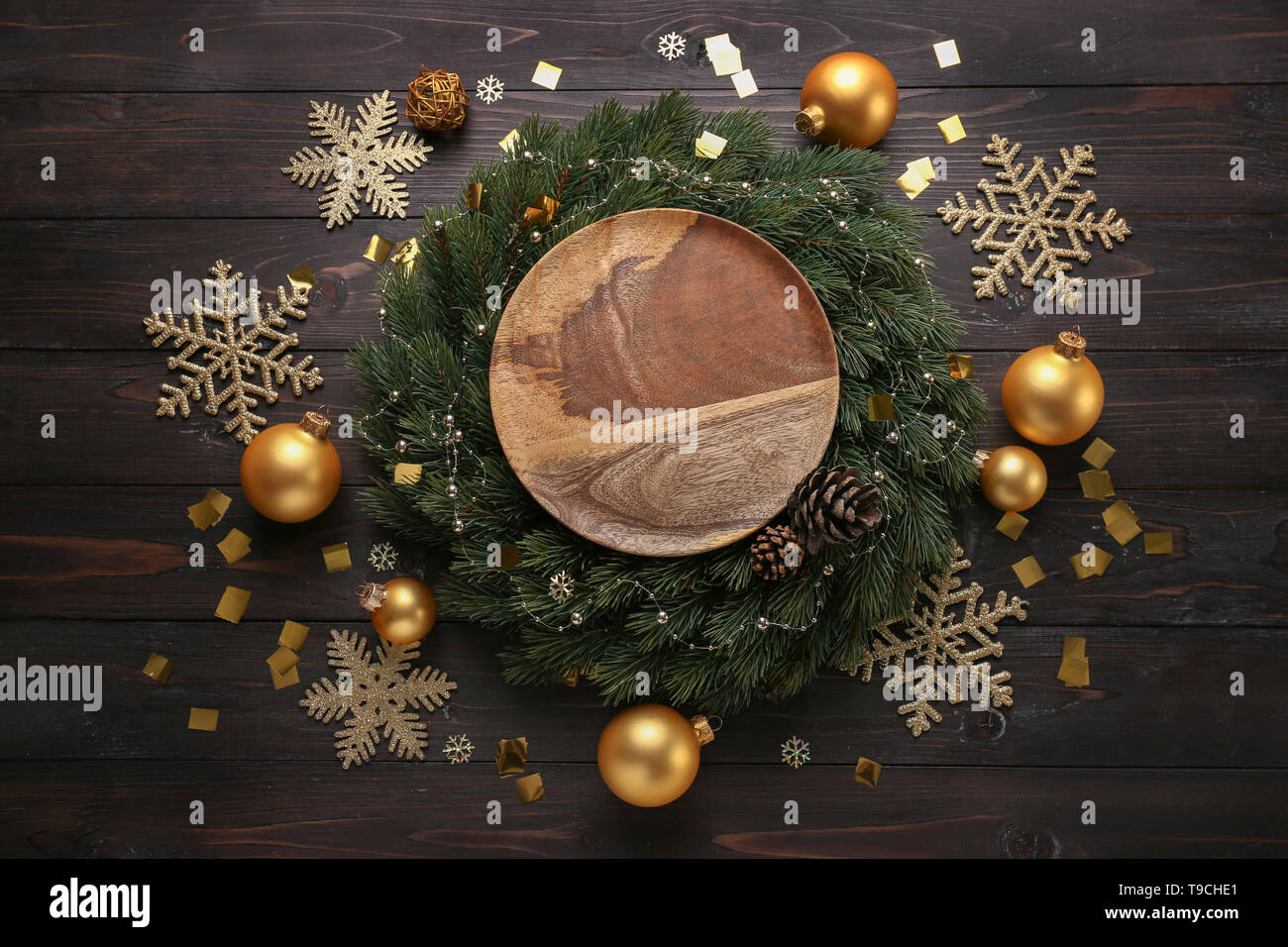 Composition With Beautiful Christmas Decorations And Plate On Wooden Table Stock Photo Alamy