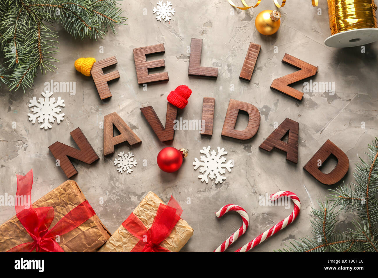 Words Feliz Navidad Made With Wooden Letters And Christmas
