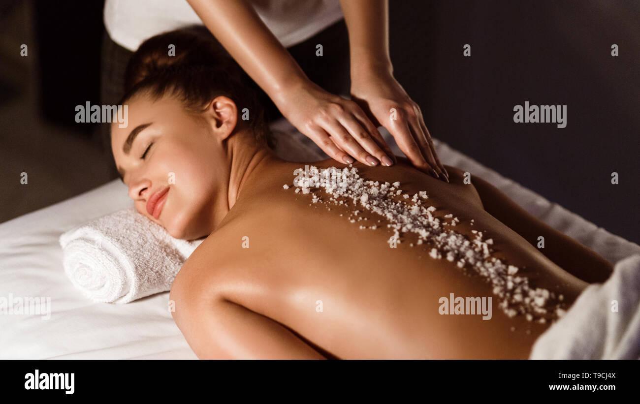 Salt Scrub Massage. Woman Relaxing In Health Spa - Stock Image