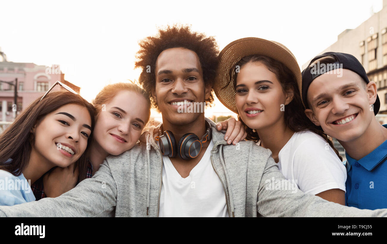 Multiethnic Teen Friends Taking Selfie Together Outdoor - Stock Image